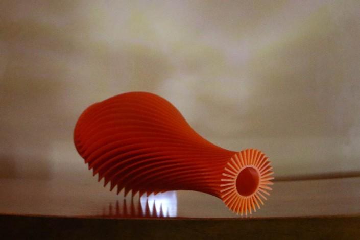 spiral orange 3d printed vase